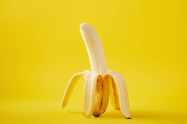 close up view of ripe banana isolated on yellow