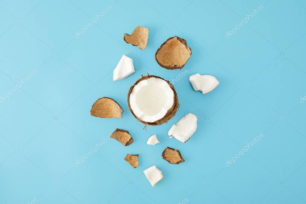 top view of arranged coconut pieces isolated on blue