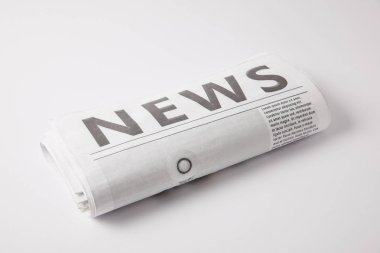 one daily newspaper lying on white background