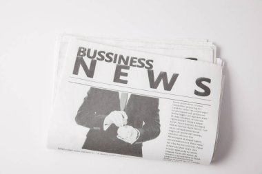 one business newspaper lying on white background