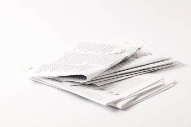 heap of black and white newspapers, isolated on white