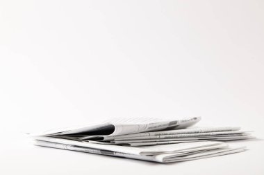 Pile of business newspapers, isolated on white with copy space stock vector