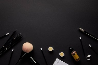elevated view of tools for permanent makeup isolated on black