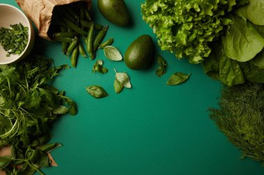 top view of different ripe vegetables on green surface