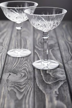 Two empty glasses on grey wooden tabletop stock vector