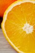 close-up shot of half of orange on wooden surface