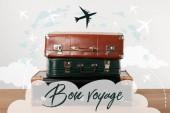 Skládaný staré kožené cestovní tašky s letadly a šťastnou cestu (mají hezký výlet) inspirace