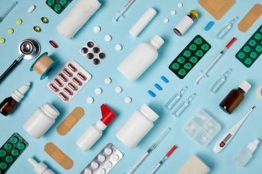 full frame shot of composed different medical supplies on blue surface