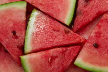 full frame of arranged watermelon slices as background