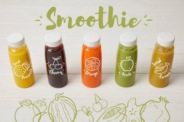 fresh organic smoothies in bottles standing in row on white, smoothie inscription