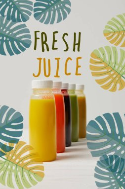organic detox smoothies in bottles standing in row, fresh juice inscription