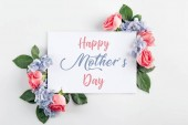 Fotografie floral composition with roses, hydrangea flowers and blank card, isolated on white, happy mothers day inscription