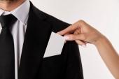 Fényképek körülvágott kép, amivel a névjegykártyát üres zseb, elszigetelt fehér background üzletember üzletasszony