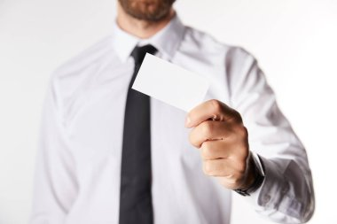 cropped image of businessman holding empty business card isolated on white background