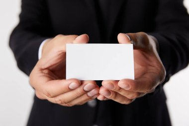 partial view of businessman presenting empty business card isolated on white background