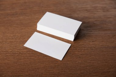 selective focus of stack of empty business cards at wooden table