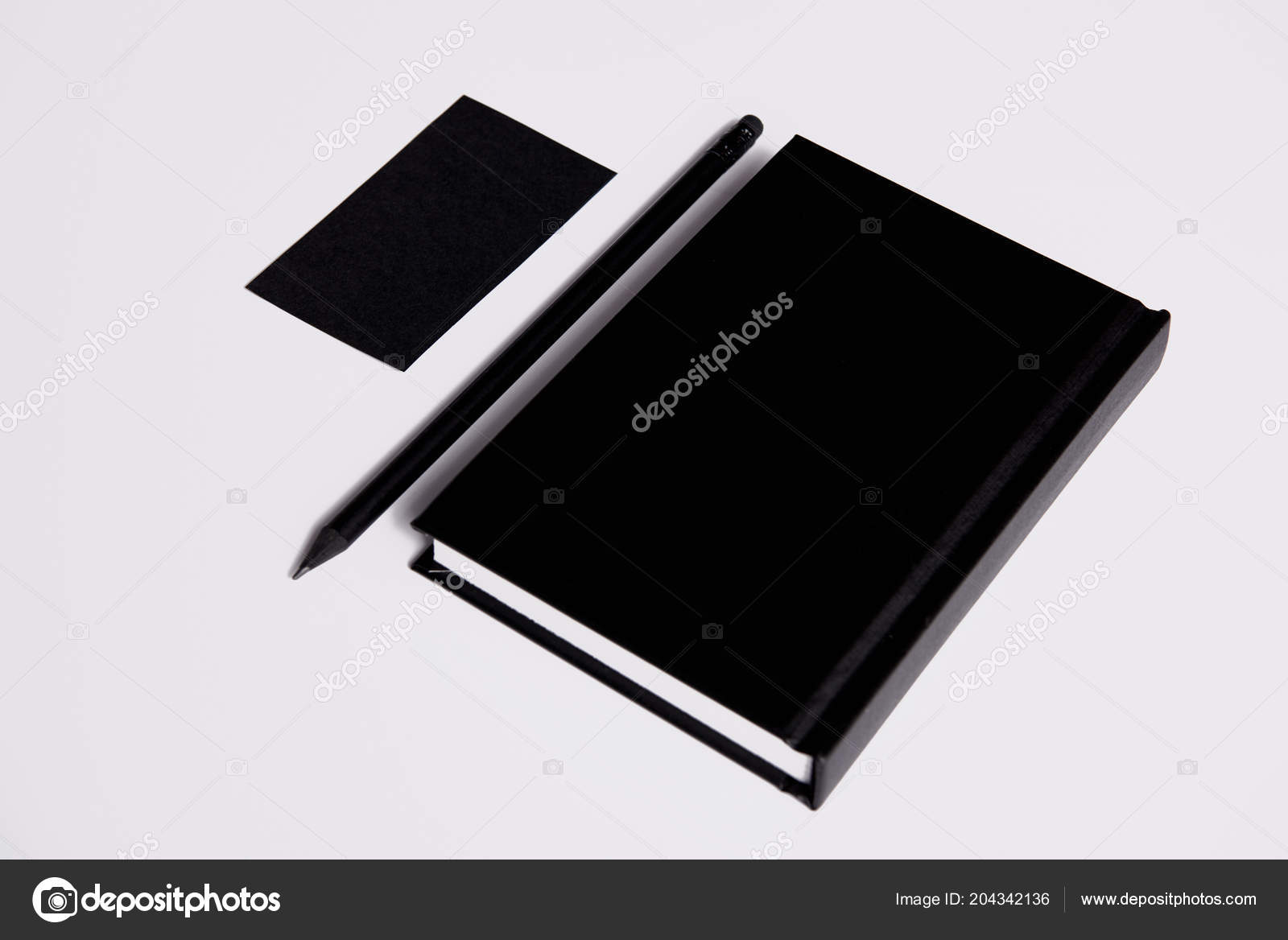 Isometric view black notebook pencil business card white surface isometric view black notebook pencil business card white surface mockup stock photo colourmoves