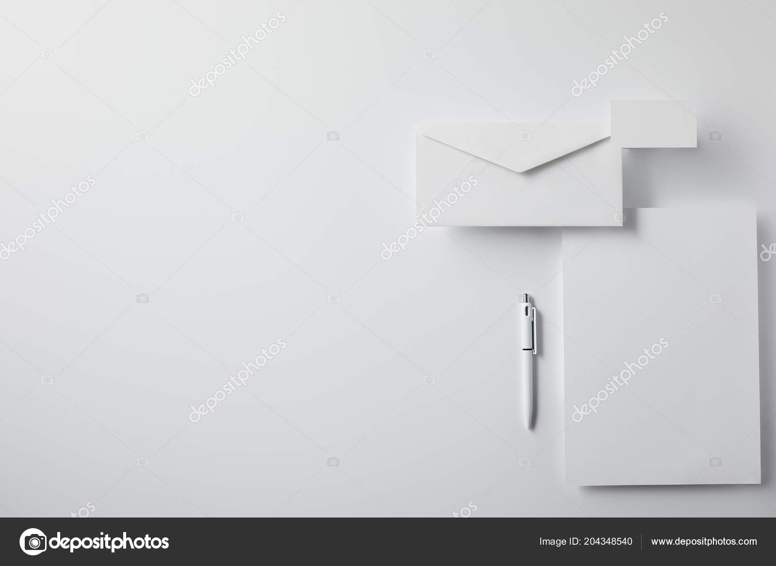 Top view layered envelope pen blank paper business card white top view layered envelope pen blank paper business card white fotografia de stock reheart Choice Image