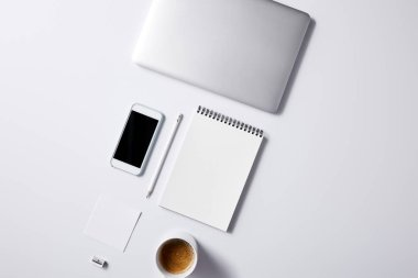 top view of arranged various business workplace objects on white tabletop for mockup