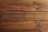 close-up view of dark brown wooden planks background