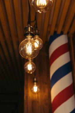 close-up view of illuminated light bulbs in stylish loft interior