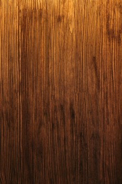 Close-up view of dark brown wooden textured background stock vector