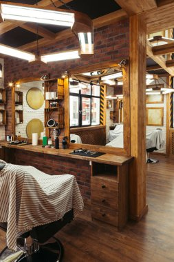 stylish illuminated barbershop with modern interior