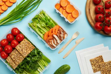 flat lay with cutlery healthy food composition isolated on blue