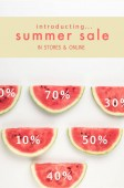Photo top view of watermelon slices with discount percents and summer sale lettering