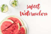 top view of watermelon slices on plate and lemonade in glasses, with sweet watermelon lettering