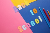 Fotografie back to school lettering with pencils on creative paper background