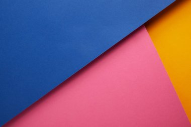 background with blue, pink and yellow papers