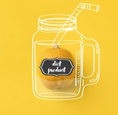 Fotografie One ripe pumpkin isolated on yellow with diet product lettering on illustration of drinking jar with straw