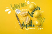 Fotografie Top view of knife and ripe lemons isolated on yellow with when life gives you lemons, grab salt and tequila lettering