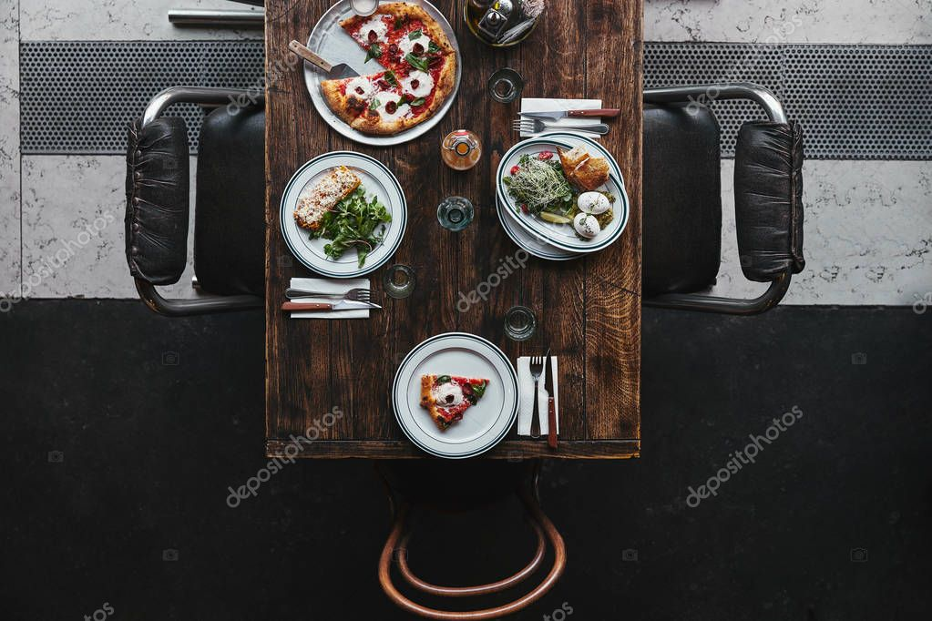 Top view of tasty italian dishes and drinks on wooden rustic table at restaurant stock vector