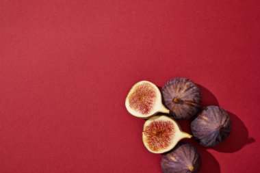 top view of fresh ripe healthy figs on red background