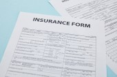Fotografie close-up view of insurance form on blue, insurance concept