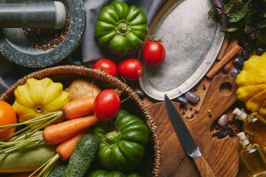 Recipe template with fresh vegetables and kitchen utensils on wooden table
