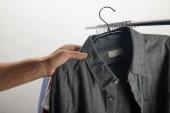 Fotografie cropped image of man taking grey shirt isolated on white