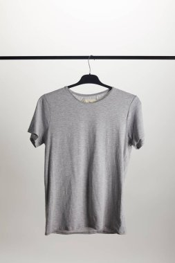 One grey shirt on hanger isolated on white stock vector