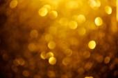 abstrakt verschwommener goldener Hintergrund zum Feiern