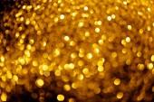 Fotografia sfondo astratto con glitter oro offuscata