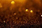 Fotografia sfondo astratto con glitter oro e bokeh