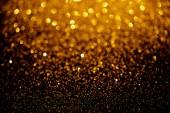 Fotografia texture di glitter oro offuscata, sfondo vacanza