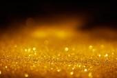 absztrakt homályos arany csillogó sötét háttér