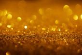 abstraktní pozadí s zlaté třpytky a bokeh