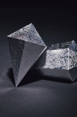 close-up view of beautiful glittering silver pieces on black