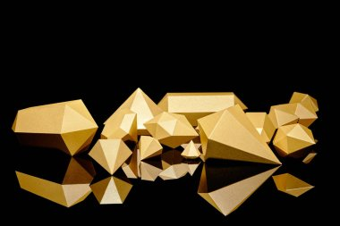Shiny glittering faceted pieces of gold reflected on black stock vector