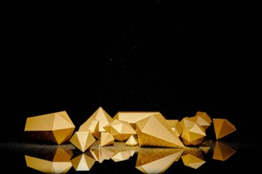 Shiny faceted golden pieces and dust reflected on black background stock vector