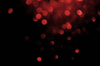 Red decorative bokeh on black background stock vector